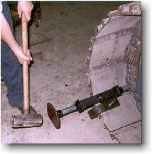 hammering track pin
