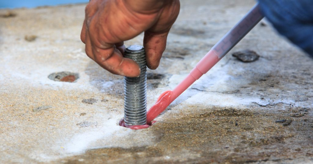 Injection adhesive chemical into the hole for preparation anchor bolt